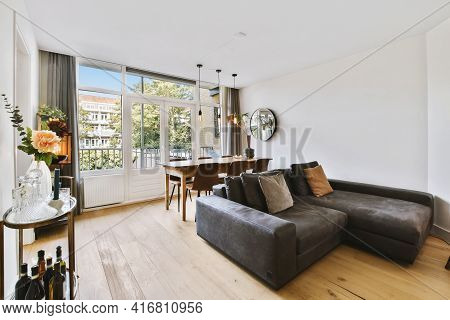 Interior Of Light Living Room With Stylish Furniture And Decorations And Glass Door And Windows Lead