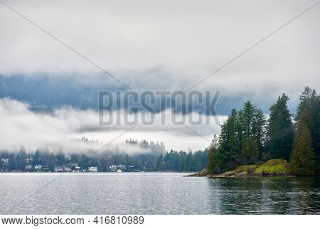 Burrard Inlet Misty Shoreline. Barnet Marine Park Shoreline. Burnaby, British Columbia, Canada.