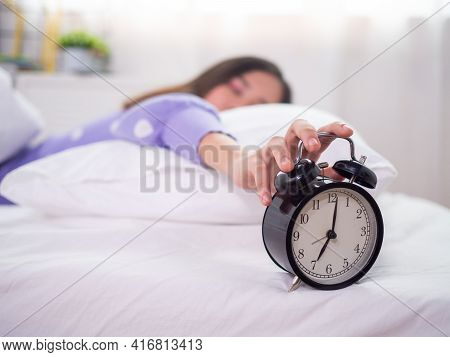 The Sleepy Woman Sleeping In Bed, Using The Hand To Press The Alarm Clock In The Morning. Good Morni