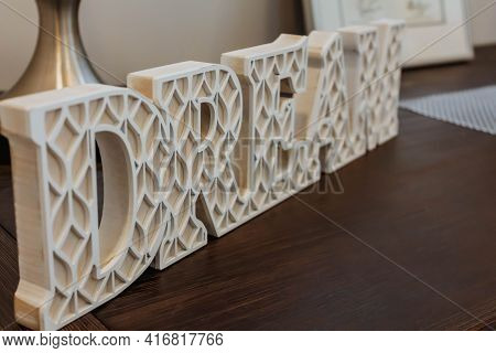 Decoration Letters Dream On Table. Word Dream On A Table. Home Sweet Home