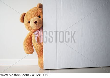 Teddy Bear With Brown Hair Behind Open Door. Background For Kids Play Teddy Bear