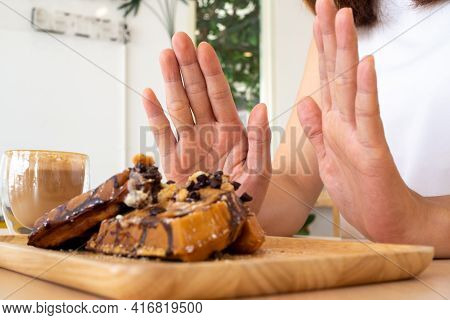 One Of The Health-care Girls Used A Hand To Push A Plate Of Chocolate Cake. Refuse To Eat Foods That