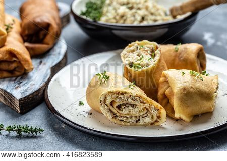 Hill Of Pancakes With Chicken Meat And Cheese. Traditional Maslenitsa Meal. Homemade Filled By Chick