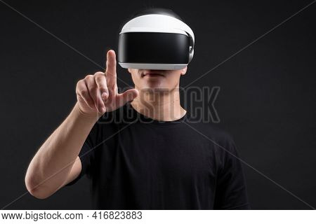 Man wearing VR goggles working on virtual invisible screen futuristic technology