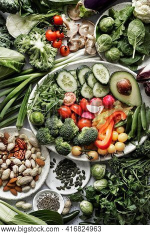 Green veggies with mixed nuts flat lay healthy lifestyle