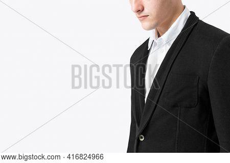 Businessman in black suit for menswear apparel studio shoot