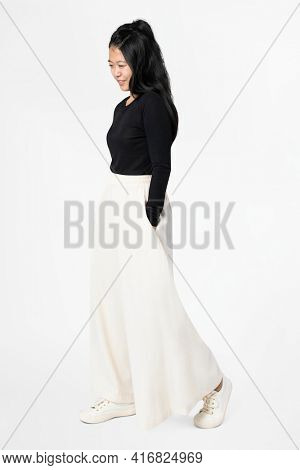 Asian woman in white palazzo pants with design space casual wear fashion full body