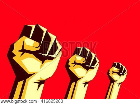 Raised Fists In The Air On The Red Background, Protest Concept. A Fight Against Social Inequality An
