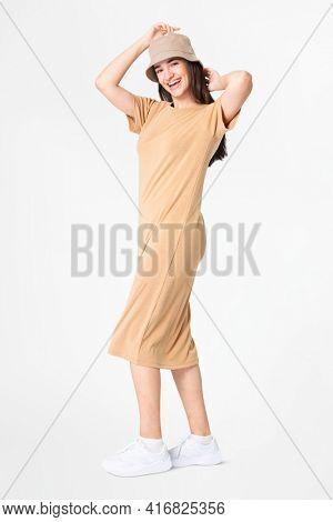 Woman in beige t-shirt dress and bucket hat casual wear apparel