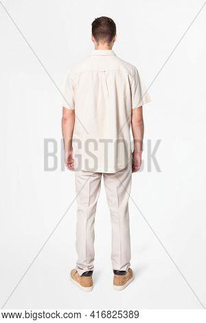 Man in beige shirt and pants casual wear fashion rear view