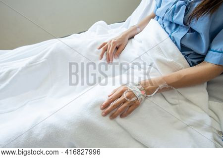 Patient Woman Sleeping With Receiving Intravenous Fluid Directly Into A Vein.