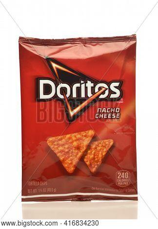 IRVINE, CA - APRIL 4, 2019: A bag of of Dorito Nacho Cheese Tortilla Chips from Frito-Lay.