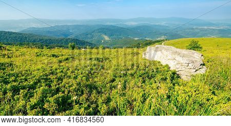 Summer Mountain Landscape With Stones On The Hill. Wonderful View In To The Distant Valley On A Sunn
