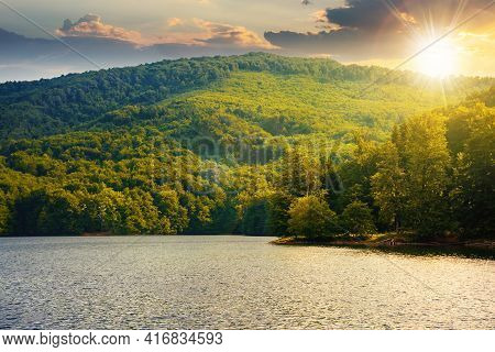 Lake Among Beech Forest In Summer At Sunset. Beautiful Nature Landscape In Mountains. Vihorlat Natio