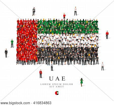 A Large Group Of People Are Standing In Green, White, Black And Red Robes, Symbolizing The Flag Of T