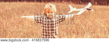 Child Playing With Toy Airplane. Happy Child Playing. Happy Child Playing Outdoors. Happy Boy Play A