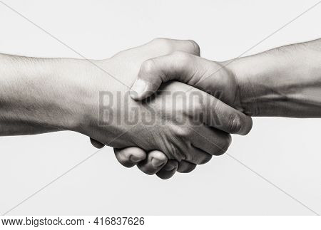 Handshake, Arms Friendship. Friendly Handshake, Friends Greeting, Teamwork, Friendship. Close-up. Re