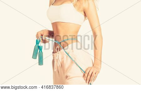 Slim Body, Jump Rope. Girl With Perfect Waist With A Jump Rope In Hands. Fit Fitness Girl Measuring