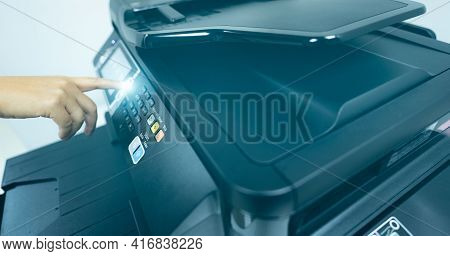 Office Worker Hand Press Button On Multifunction Laser Printer. Copy, Print, Scan, And Fax Machine I