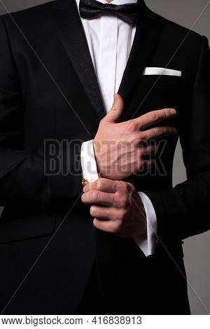 Retro Suit Fashion. Formal Classic Suit. Business Style Outfit. Handsome Businessman Adjusting His S