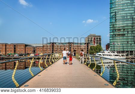 London / Uk - August 23 2019: People Walk On The North Dock Pedestrian Bridge That Spans The North D