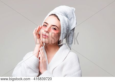 Portrait Of Beauty Woman With Eye Patches Showing An Effect Of Perfect Skin. Under Eye Masks For Puf
