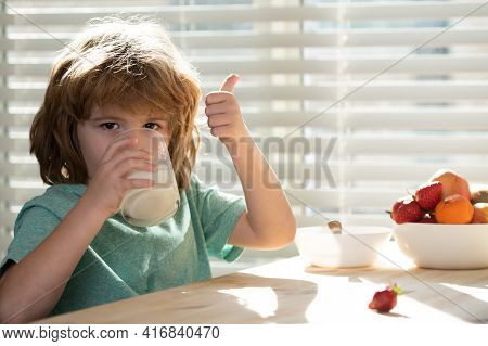Close Up Of Cute Little Boy Kid Drink Tasty Organic Milk With Vitamins Calcium From Glass. Small Chi