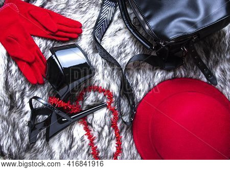 Flat Lay Collage With Woman's Black High-heeled Shoes, Red Hat And Bag On Wolf Fur Background. Femal