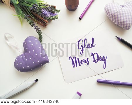 Glad Mors Dag, Swedish Thank You Mother As Brush Lettering On A Mothers Day Greeting Card On A White