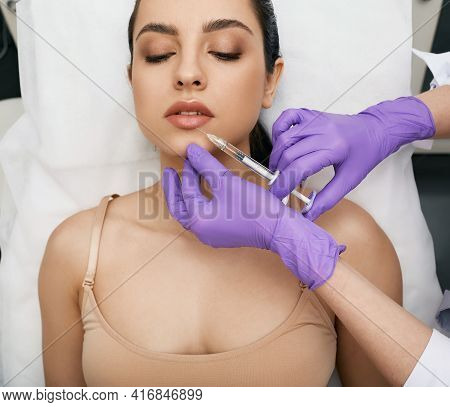 Lip Augmentation Procedure. Filler Injection For Beautiful Woman Lip Augmentation With Hyaluronic At
