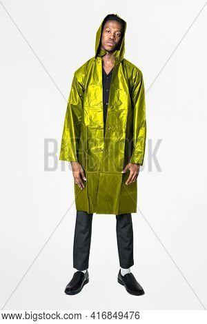 Man in green reflective raincoat men's street fashion full body