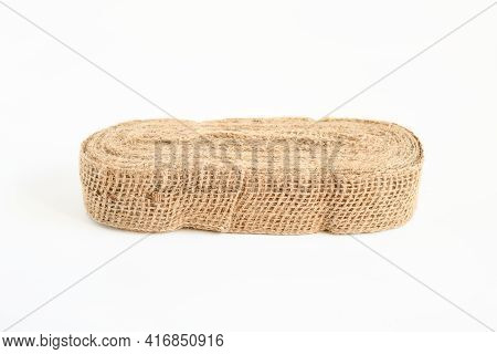 Top View Roll Nature Burlap Fabric Patch Label,  On White Background ,sackcloth Piece Idea For Creat