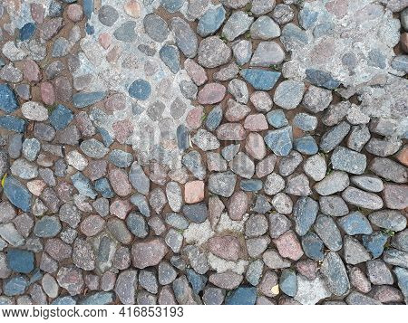 Blue And Pink Cobbles On The Ground As Ab Ackground