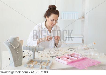 Professional Accessories Designer Making Handmade Jewelry In Studio Workshop. Fashion, Creativity An