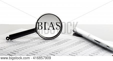 Magnifying Glass With Text Bias On The Chart Background With Pen