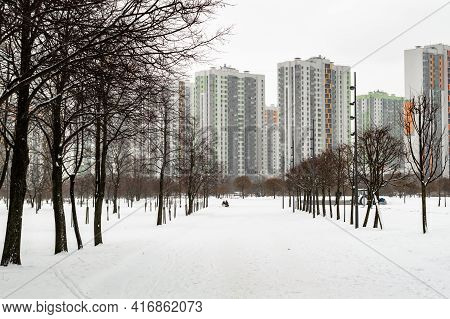 Winter Alley Leading To High-rise Apartment Buildings. High Quality Photo