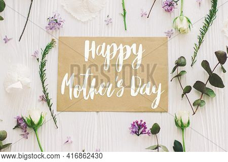 Happy Mother's Day. Happy Mother's Day Text On Paper Card And Lilac, Roses, Eucalyptus Flowers Compo