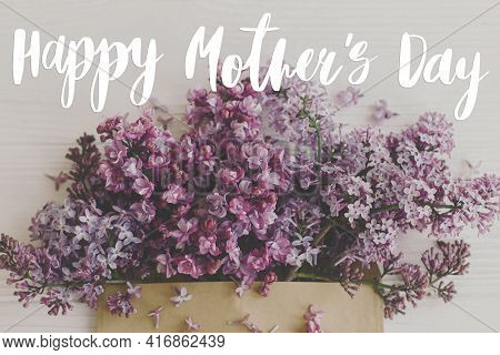 Happy Mother's Day. Happy Mother's Day Text And Purple Lilac Blooming From Craft Envelope On White W