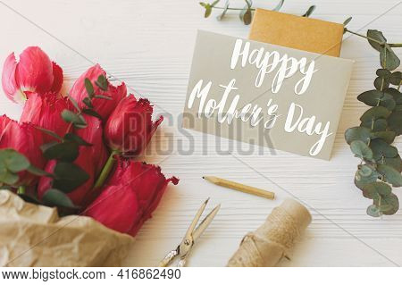 Happy Mother's Day. Happy Mother's Day Text On Card And Red Tulips, Gift, Pencil, Scissors And Twine