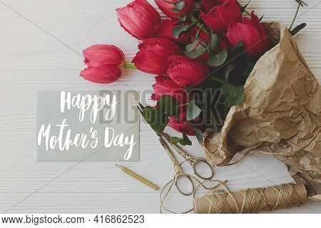 Happy Mother's Day. Happy Mother's Day Text On Card And Red Tulips, Pencil, Scissors And Twine On Ru