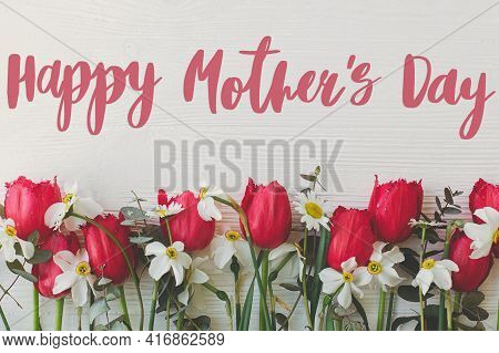 Happy Mother's Day. Happy Mother's Day Text And Red Tulips, Daffodils, Daisy Flowers Border On White