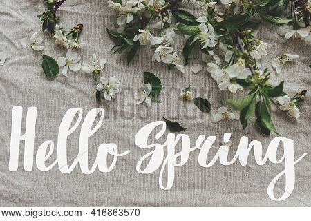 Hello Spring. Hello Spring Text And Spring Flowers, Cherry Blossoms, Petals, Leaves On Linen Cloth.