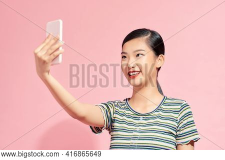 Selfie! Cheerful Young Asian Woman Holding Mobile Phone And Making Selfie By Her Smart Phone While S