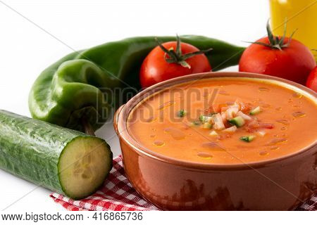 Gazpacho Soup In Crock Pot And Ingredients Isolated On White Background