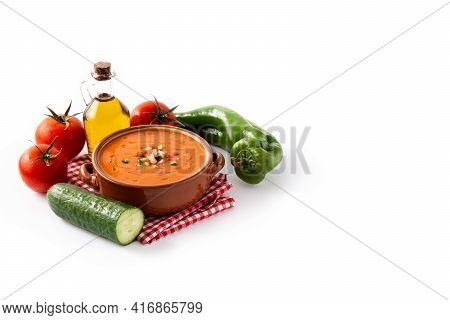 Gazpacho Soup In Crock Pot And Ingredients Isolated On White Background. Copy Space