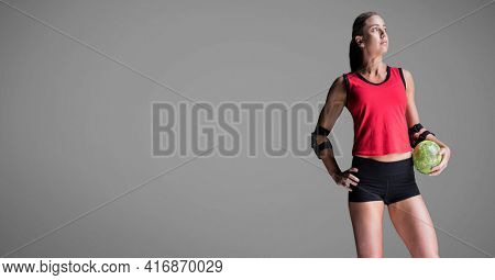 Blonde caucasian woman holding a softball, looking away, over grey background. sports concept, digitally generated image.