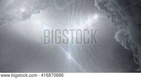 Clouds over grey sky and stadium lighting background. sports and events background, digitally generated image.