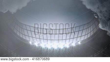 Clouds over large sports stadium with grey sky background. sports and events concept, digitally generated image.