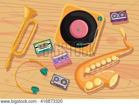 Cassette Tapes, Vinyl Player And Musical Instruments On Table. Tapes, Record Player, Saxophone, Trum