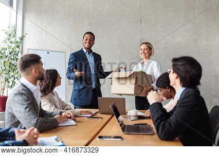 African Hr Manager Introducing New Employee To Colleagues In Office